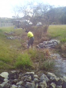 Creek regeneration, using large rocks to create meanders in the creekline.