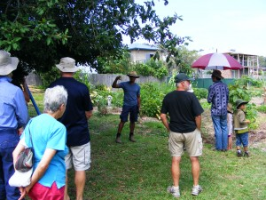 Arlan - Giving the Coffs Harbour ambassador  Tour through the Community garden